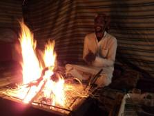 The camp fire with Suleiman singing and tea brewing.